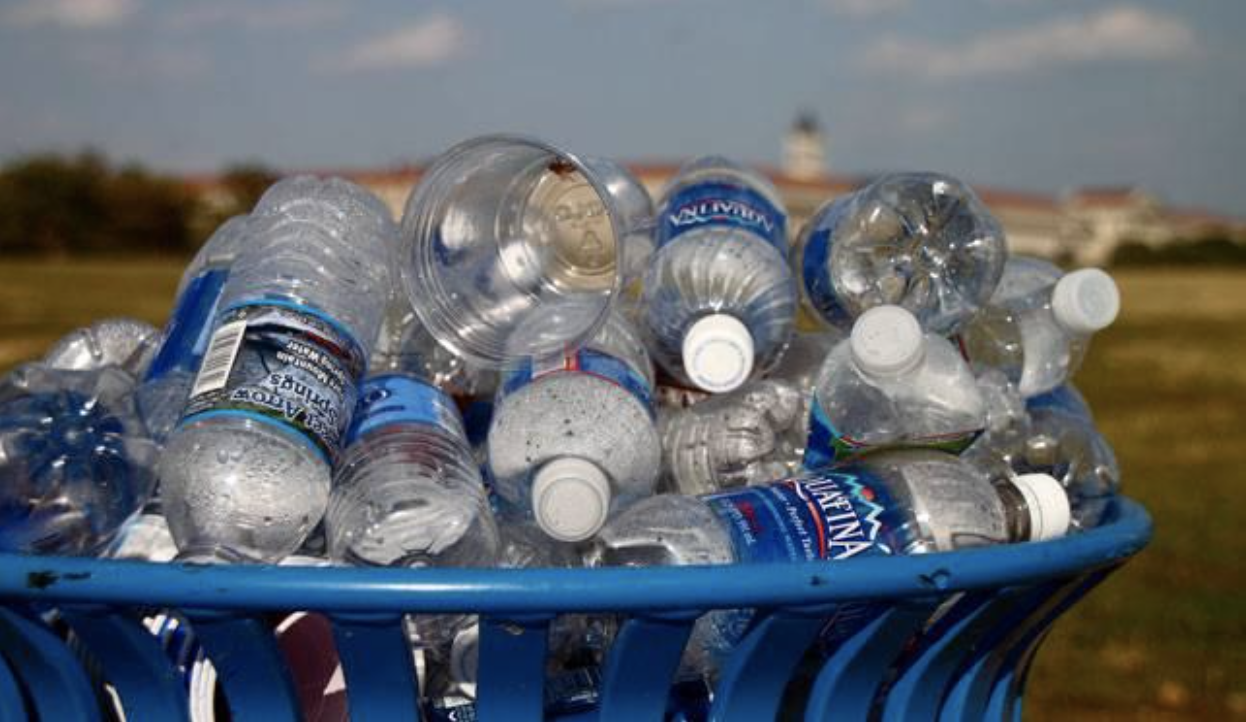 overflowing garbage with plastic bottles